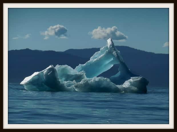 Large floating blue iceberg in Alaska.