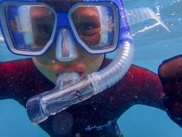 A child scuba diving in the Great Barrier reef