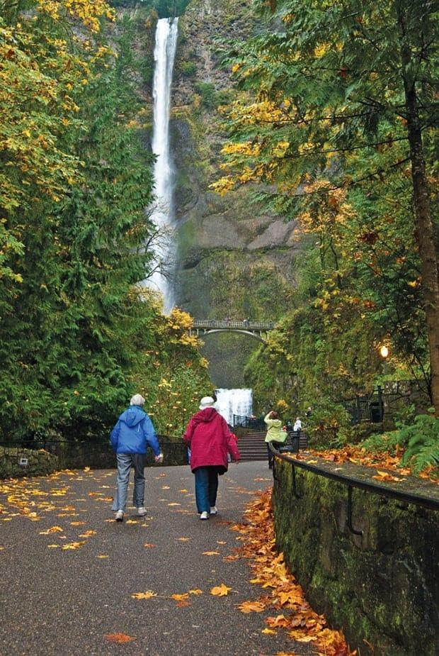 People walking in front of Multnomah Falls in Oregon.