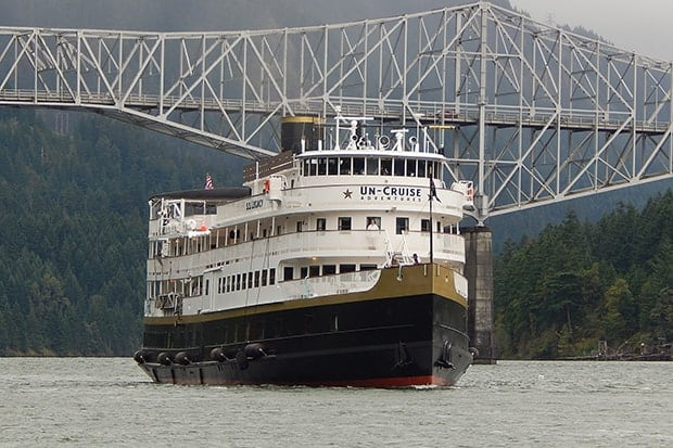 S.S. Legacy small ship under bridge on Columbia River.