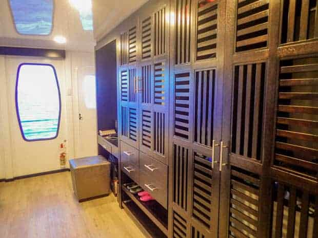 Storage area on the small ship catamaran Alya with a door access out to the deck.