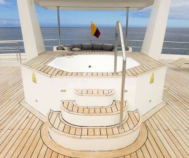 View of the stern of the boat with a hot tub and couch.