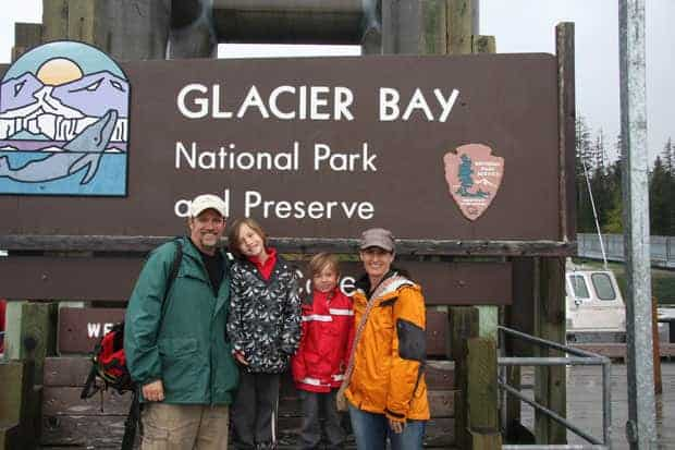 Family aboard a small ship cruise in Alaska visiting Glacier Bay National Park.