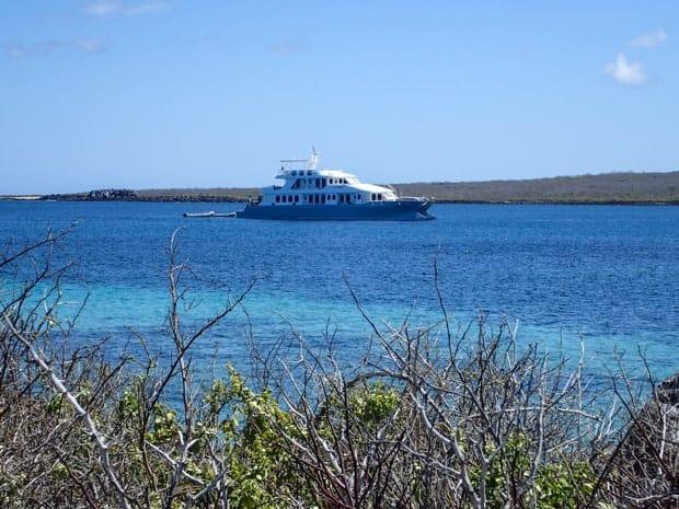 Small ship cruise catamaran Alya anchored off the coast in the Galapagos.