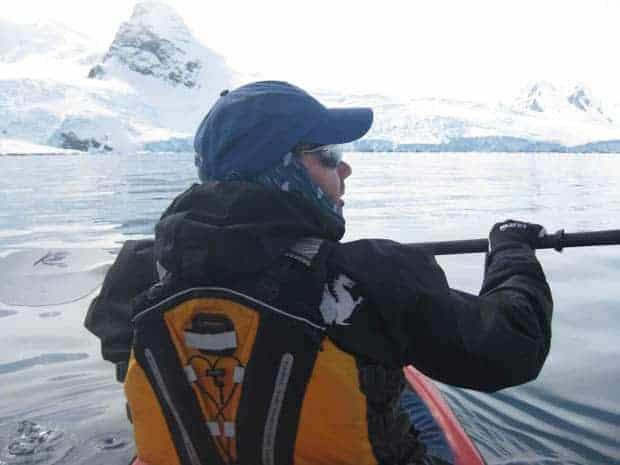Guest from small ship cruise kayaking in Antarctica.