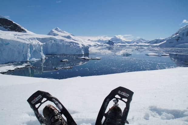 Guest from small ship cruise snowshoeing in Antarctica.