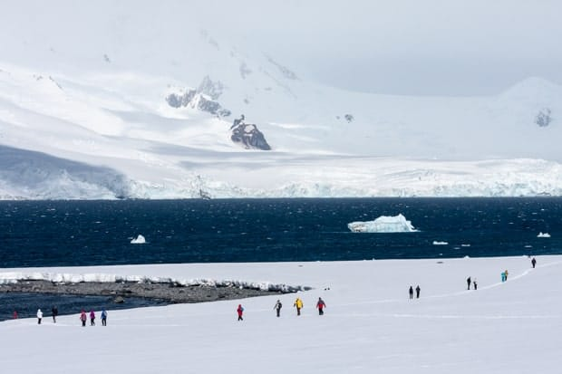 Small cruise ship hiking excursion on the snow in Antarctica.