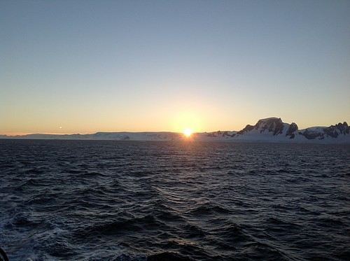 Sunset in Antarctica seen from a small ship cruise.