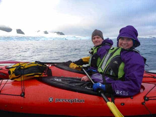 Two guests from a small ship cruise on a kayaking excursion in Antarctica.