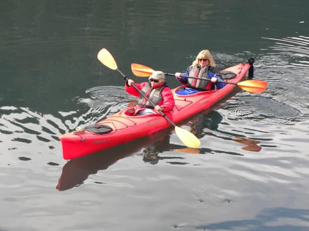2 small ship travelers kayaking in Alaska.