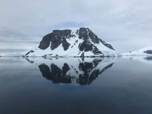 Snowy rock formation seen from a small cruse ship in Antarctica.