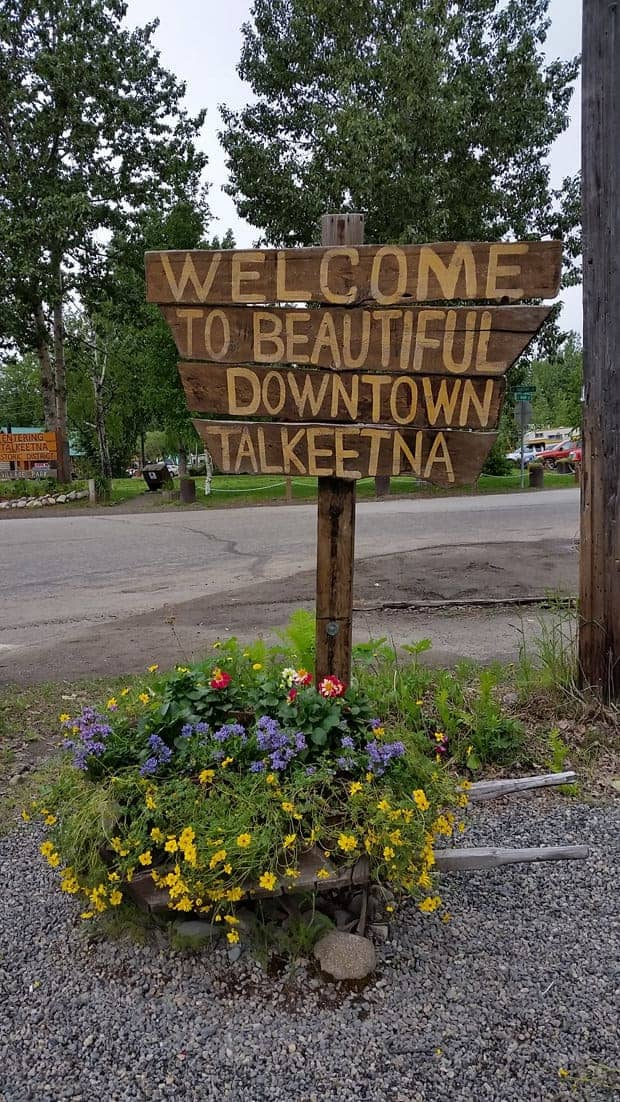 Wooden sign with flowers of Talkeetna in Alaska.