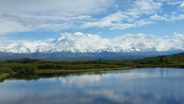 Wonder Lake with Alaskan snow-capped mountain range.