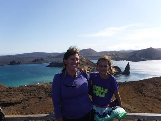 Mother and daughter smiling on a hiking tour in the Galapagos from their small ship cruise.