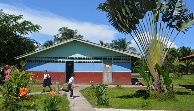 Children walking in front of the Laguna de Tortuguero School in Costa Rica.