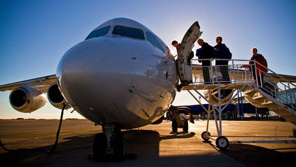 Guests board a plane from the tarmac to start a seamless Chile vacation.