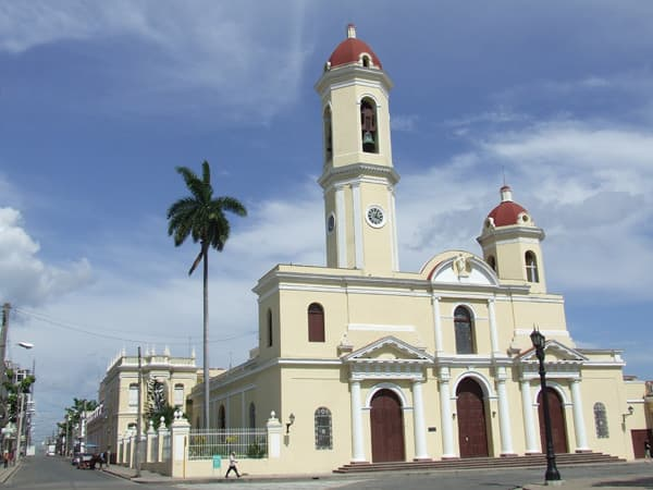 cuban church with a palm tree next to it