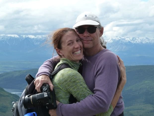 Happy couple in an embrace overlooking Juneau, Alaska.