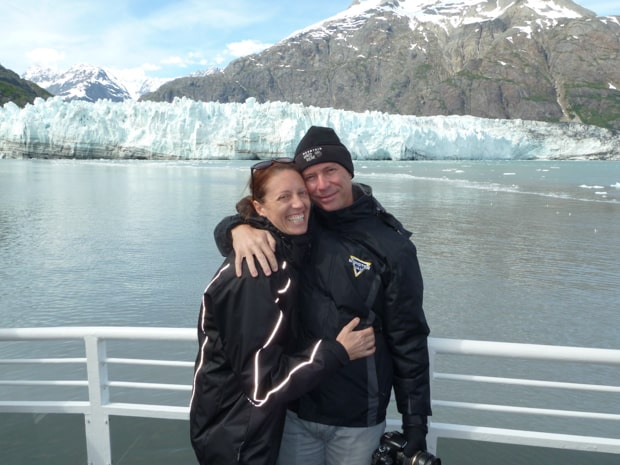 John's Hopkins tidewater glacier with happy Alaskan travelers on the deck of a day cruise.